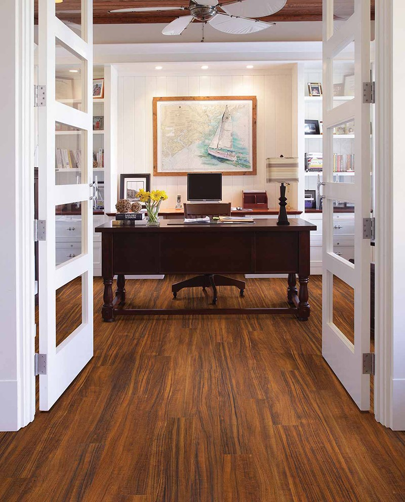 Nautical themed office with wood desk and wood flooring