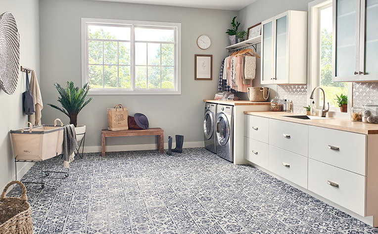 Light colored tile floor in laundry room